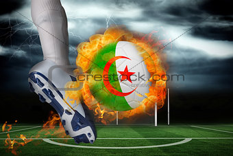 Football player kicking flaming algeria flag ball
