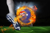 Football player kicking flaming australia flag ball