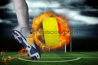 Football player kicking flaming belgium flag ball