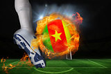 Football player kicking flaming cameroon flag ball