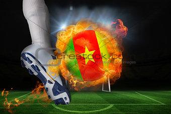 Football player kicking flaming cameroon flag ball