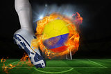 Football player kicking flaming colombia flag ball