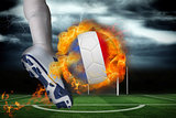 Football player kicking flaming france flag ball