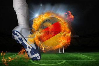 Football player kicking flaming germany flag ball