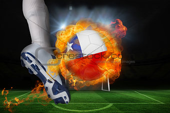 Football player kicking flaming chile flag ball