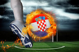 Football player kicking flaming croatia flag ball