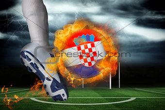 Football player kicking flaming croatia flag ball