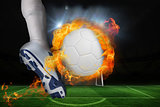 Football player kicking flaming ball