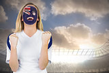 Excited australia fan in face paint cheering