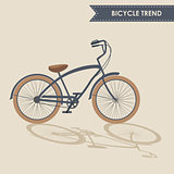 Trendy bike with brown wheels and oblique shadow on beige background isolated