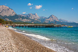 Shingle beach and sea view in Kemer, Turkey.