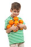 Boy holding oranges