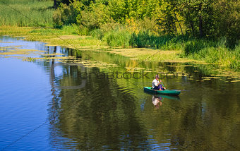 Man Fishing Out Of A Row Boat