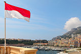 Monaco flag and Monte Carlo skyine.