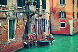 Boat and old brick house in Venice, Italy.