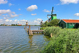 Wooden windmills in dutch village.