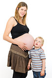 Pregnant mother with a little boy brother