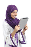 Arab happy woman reading a tablet reader