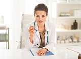 Medical doctor woman sitting in office and explaining