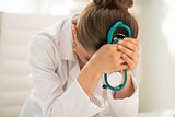 Stressed medical doctor woman in office