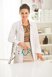 Portrait of smiling medical doctor woman in office
