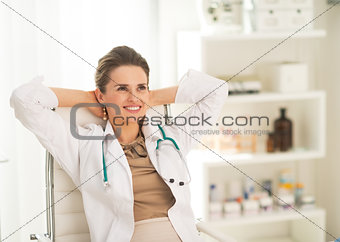 Portrait of relaxed medical doctor woman in office
