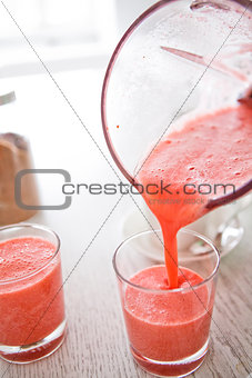 Pouring a delicious strawberry smoothie