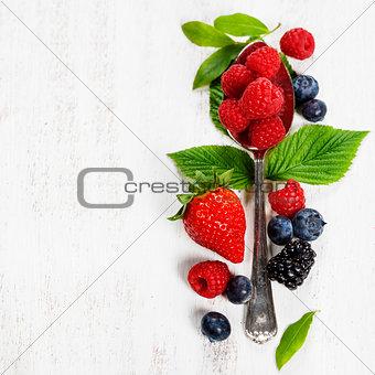 Berries with spoon  on Wooden Background. Health, Diet, Gardenin