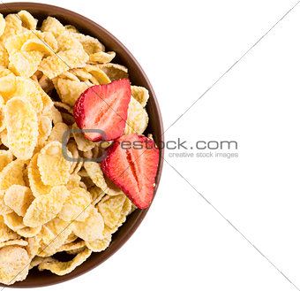 Cornflakes with strawberries on bowl