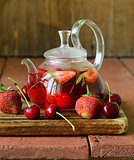 summer fruit tea with a variety of berries (cherry, strawberry)