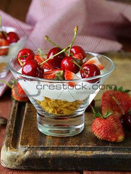 Dairy yogurt dessert with cherries and strawberries