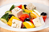 Vegetable greek salad with cheese and tomatoes