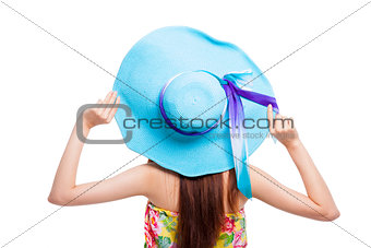 back of  girl holding a hat over white background