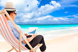 businessman sitting on beach chairs and look stock financial
