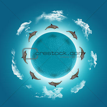 3D render of a water globe with jumping dolphins and clouds