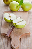 fresh green sliced apples and knife