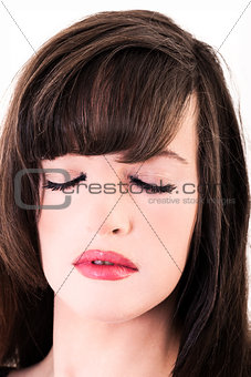 close up portrait of attractive woman with eyes closed