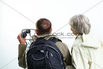 Backs of hikers