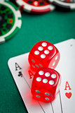 the red casino dice and poker cards