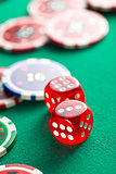 the red casino dice and casino chips