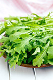 fresh arugula leaves on plate