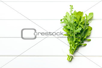 fresh arugula leaves on kitchen table