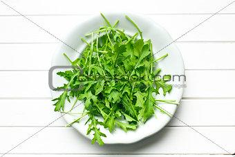 arugula leaves in plate