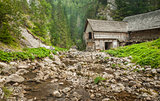 wooden cottage in the mountains with creek