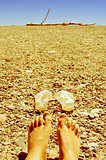 bare feet in a shingle beach