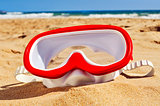 diving mask in the sand of a beach