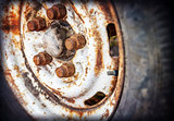 old car wheel with rusty bolts