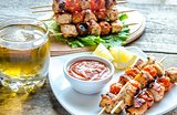 Grilled chicken skewers with cherry tomatoes