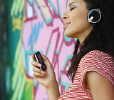 woman with headphones listen to music pop