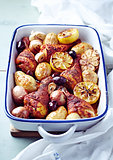 Oven-Baked Chicken with Potatoes, Garlic , Onions and Lemons
